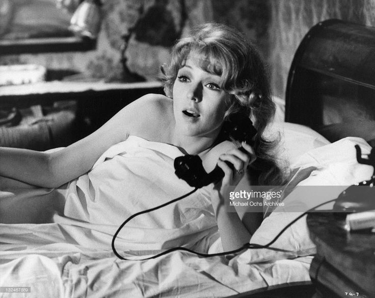 Joanna Pettet receives a telephone call from her boyfriend in a scene from the film 'The Group', 1966.