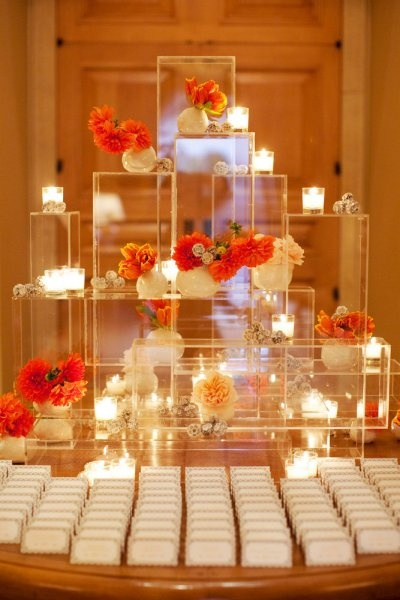 Escort cards display - love the use of clear boxes with candles and flowers