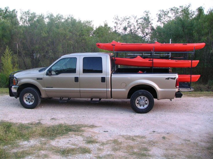 Here's a great way to haul up to (5) kayaks plus the paddles, life jackets & other gear neatly in the back of of pick-up. Outfitters in our area charge $40 per kayak per trip to drop you off upriver ($200 a day for a family of 5). With this set-up, they only charge us $25 to drop us off at the same spot & to drive my truck back to the same take-out spot downstream. That saves at least $175 each time we go!