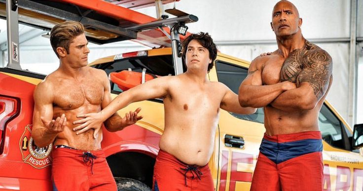 'Baywatch' Movie Cast Goes Topless in Latest Set Photo -- Zac Efron, Dwayne Johnson and Jon Bass go shirtless on the set of Paramount's upcoming 'Baywatch' movie. -- http://movieweb.com/baywatch-movie-cast-topless-photo/