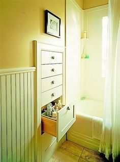 Built-In Drawers between wall studs. We did this with our bathroom vanity. The doors to the vanity consist of mirrors mounted on plywood. It's a great space-saver, and the mirrors make the small space seem much bigger.