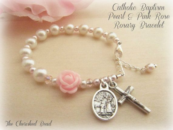 Catholic Baby Girl Baptism Rosary Bracelet with White & Pink Pearl and Rose with Guardian Angel by TheCherishedBead on Etsy https://www.etsy.com/listing/179221974/catholic-baby-girl-baptism-rosary