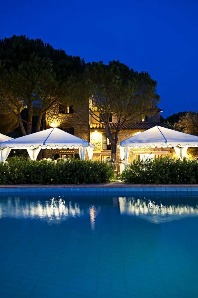 Swimming pool by night; Beautiful borgo in Tuscany for your country-chic wedding in Italy.