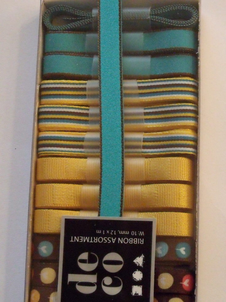 WOODWARE RIBBON COLLECTION - YELLOW BROWN TURQUOISE -      Box of yellow, brown and turquoise coloured ribbons with 12 m of ribbon in 1m lengths. 3 of each of the 4 designs.