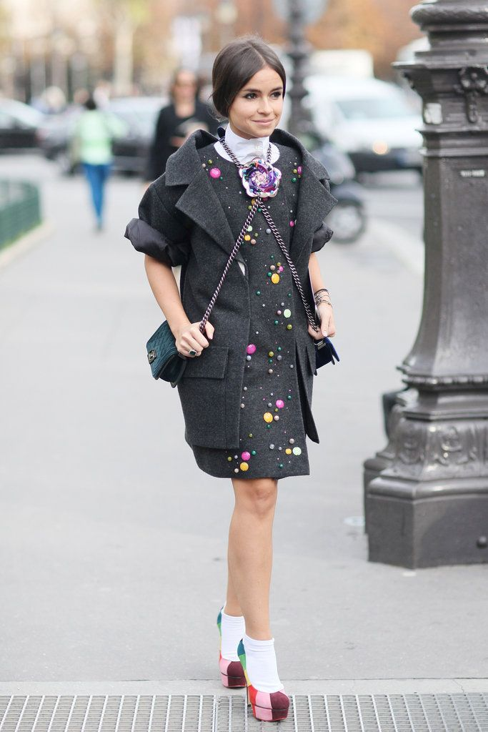 Miroslava Dumo kept her whimsical street charm coming in a Chanel ensemble and rainbow platform pumps. PFW