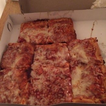 Photo of Della Sala's Pizza - Verona, PA, United States. Pizza in the to-go box
