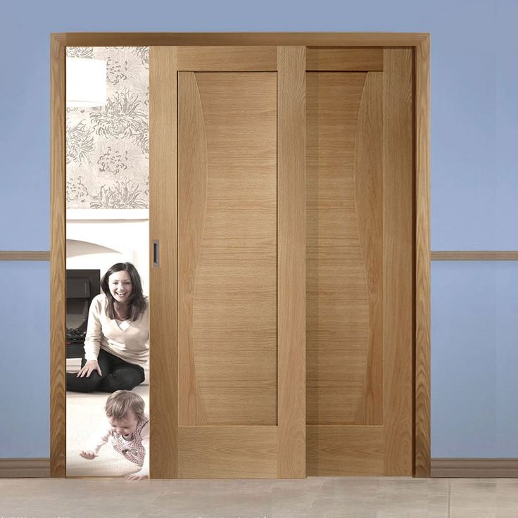 Easi-Slide OP3 Oak Emelia Flush Sliding Door System in Three Size Widths. #oakdoors #slidingdoors #xljoinerydoors
