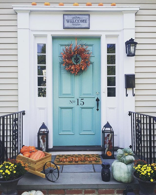 What a welcome! @tonal_painting and @jordecor create serious #curbappeal with a door in St. Lucia Teal 683 and fall décor.
