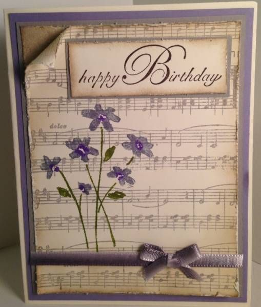 Coloured card,different coloured card behind curl, inked distressed music sheet ink all over amd more heavily on edges, curl top corner, wrap ribbon around it and tie a separate bow, stamp an image and colour in with gel pens, or could use a sticker, multi dye for greeting