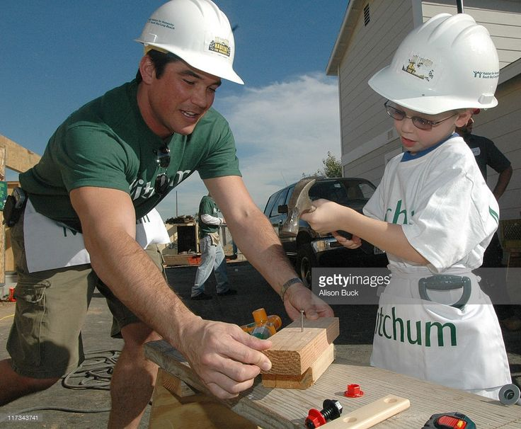 Dean Cain and his son during Mitchum teams up with Habitat for Humanity to Build a 'Sweet-Equity' Home at Plaza Del Amo in Torrance, California, United States.