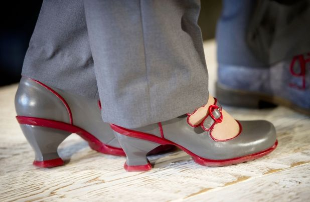 Air Canada rouge's new in-flight uniform, including John Fluevog shoes, is modeled during a press conference in Toronto Monday, May 27, 2013.