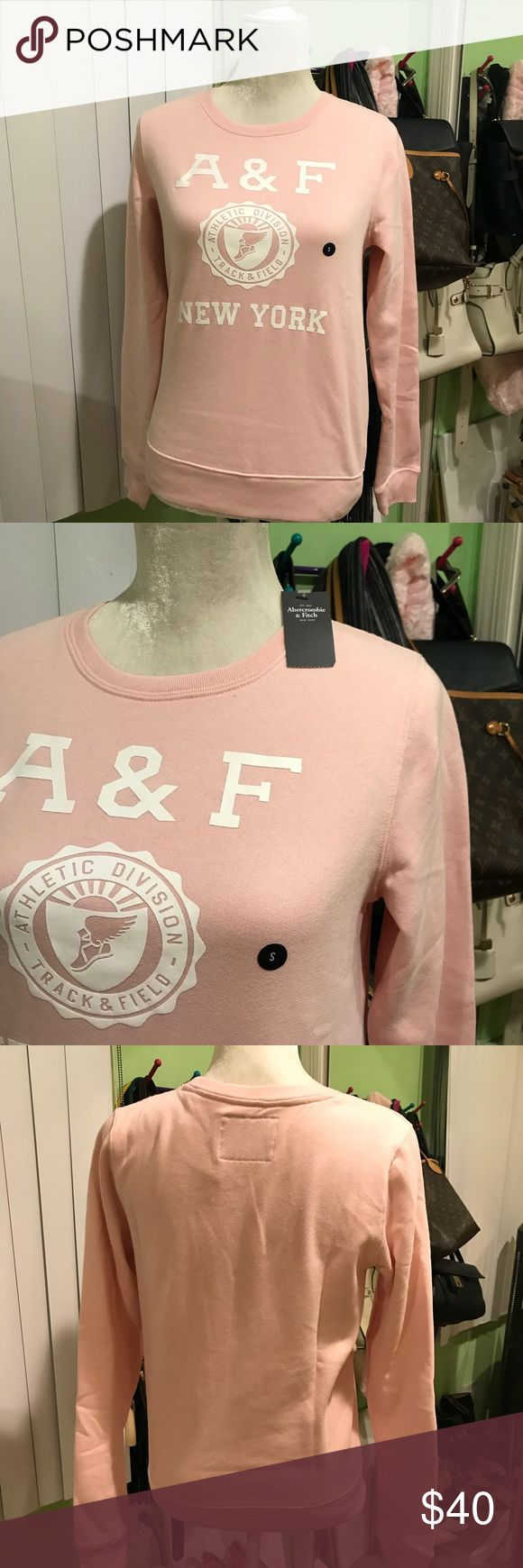 Abercrombie and Fitch Pink Sweatshirt New with tags  Really soft  Abercrombie and Fitch New York Athletic Division Track and Field Pink Sweatshirt Abercrombie & Fitch Tops Sweatshirts & Hoodies