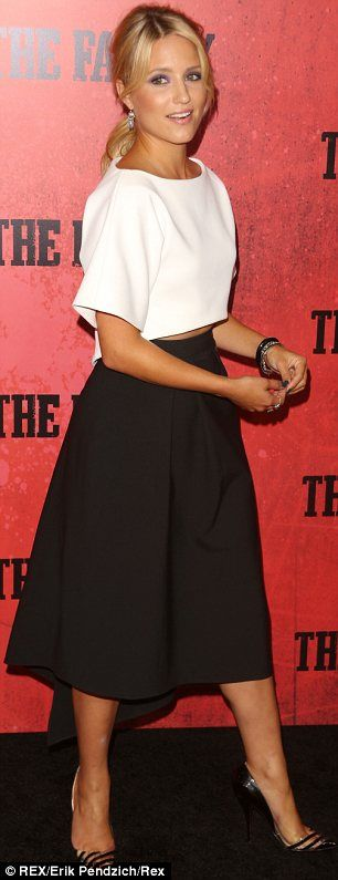 Demure: The 27-year-old Glee star Diana Agron wore a white crop top and high-waisted black skirt by Osman which flashed just a hint of her toned tummy