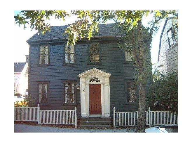 dark house dark trim   dark blue, with black? trim and white around door