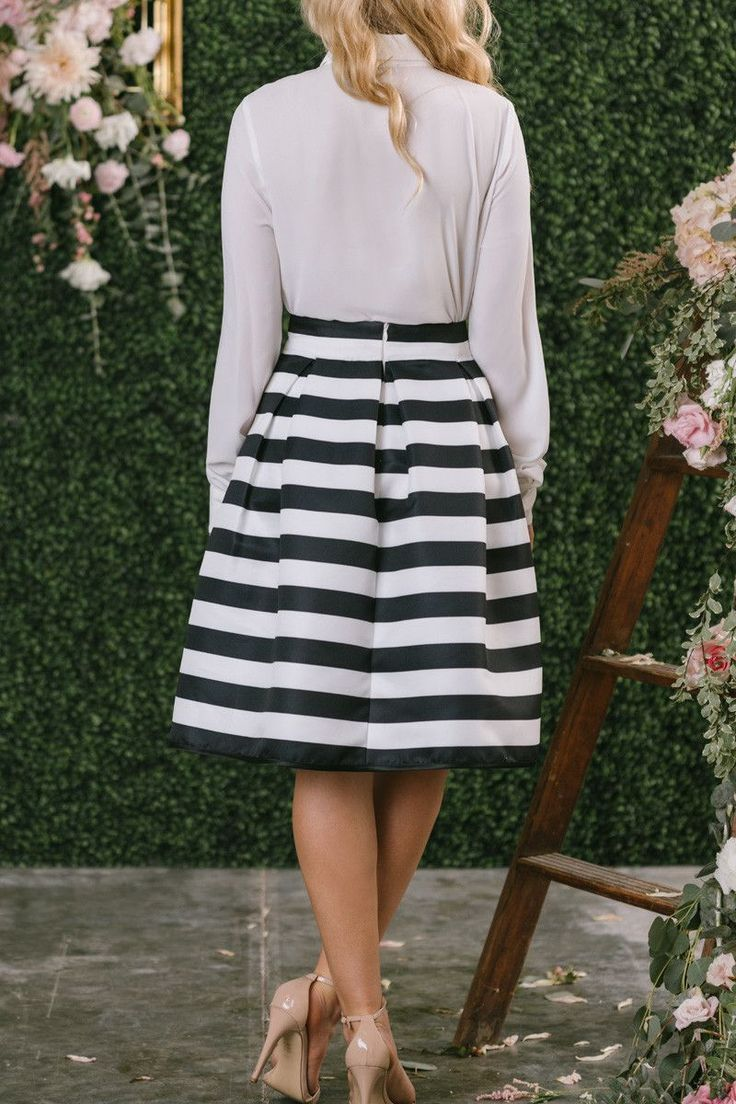 This parisian inspired piece is one of our favorite new midi skirts! The chic black and white striped pattern and flared shape of this piece makes it perfect for pairing with crop tops for a feminine
