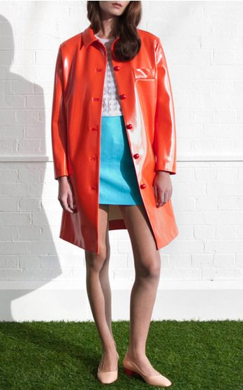 Dubbed a designer to watch, Serafina Sama lives up to the hype with SS15. Looking to Hockney's paintings of Palm Springs in the '60s, the breakout talent applies the artist's pop-bright aesthetic to retro silhouettes like sunset-orange vinyl trenches and Campari-red cotton dresses. The result is relaxed glamour.