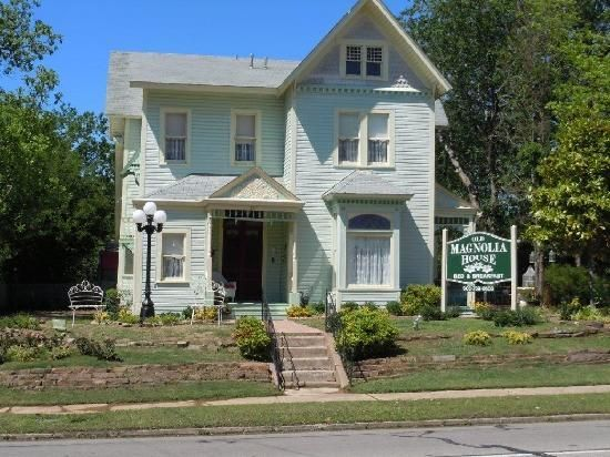 """Located in the beautiful and historic city of Paris, Texas, Old Magnolia House was built in 1871 by the Ledger family. It is a 2 story Victorian home with original stained glass windows and """"beveled & etched"""" front doors with the letter """"L"""" etched in the glass portion of the door."""