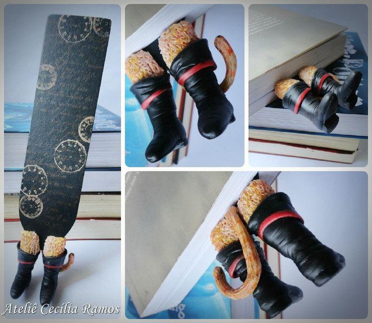 Marcador de Páginas Divertidos <br>- Perninhas Gato de Botas <br>Marcador feito em papel resistente, decoração feita em biscuit.