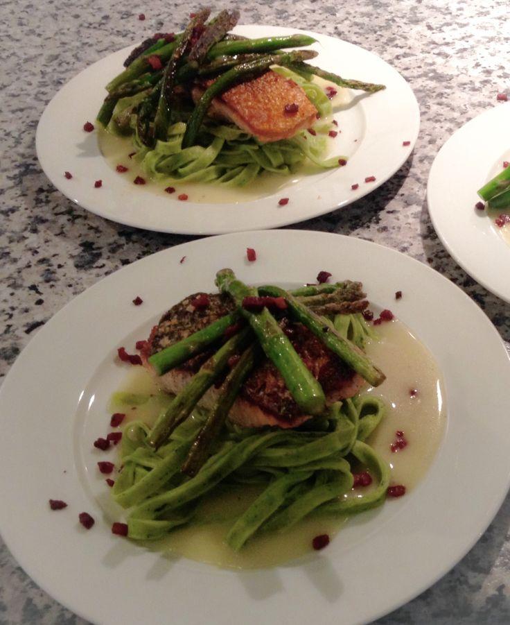 Crispy skin salmon, spinach fettuccini, asparagus with a lemon velouté sauce.