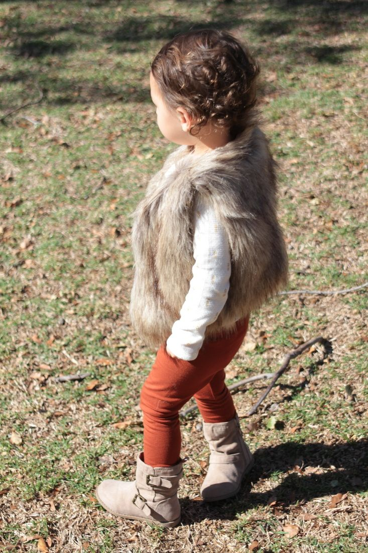 Fall Toddler Fashion; faux fur vest, paprika leggings, and boots. Details and more on www.everygoodwomanblog.com/babytoddler