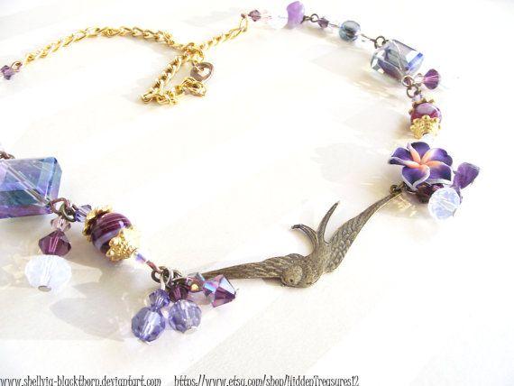 https://www.etsy.com/listing/157332779/purple-swallow-bird-necklace-gothic?