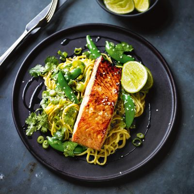 Add an oriental twist to dinner time with Teriyaki salmon and noodles, topped with a squeeze of lime.