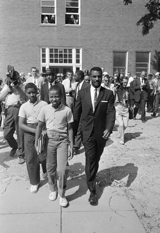 "Integration Attempt Causes An Uproar September 9, 1957  Rev. F.L. Shuttlesworth mobbed when he attempted to enroll his daughters in ""white"" Birmingham school."