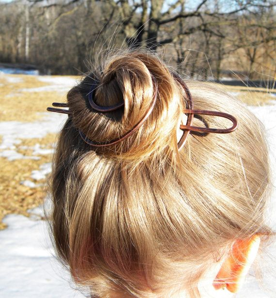Ready for the beach. This is a fantastic summer hair accessory.  Circular bun cage. Slide shown in hair wrapped into a loose bun. No binder tie