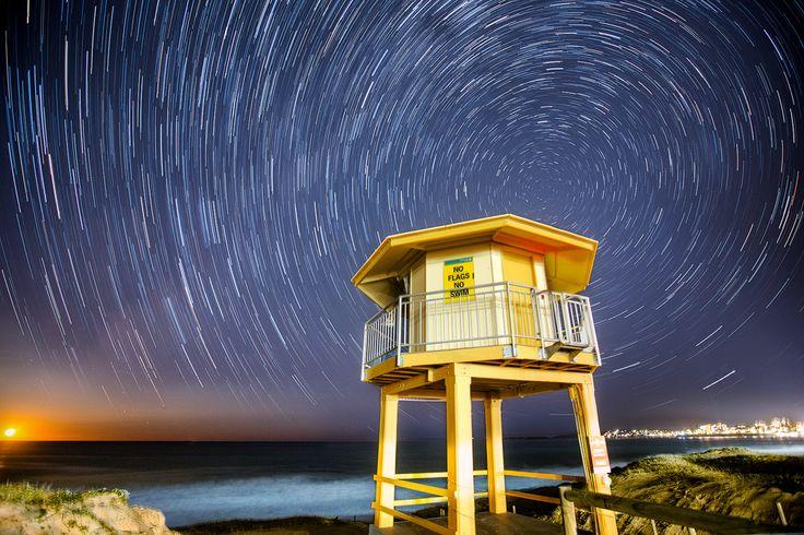Star Trails at Wanda Surf lifesaving club at Cronulla Sydney with a 3/4 moon rising at the end.