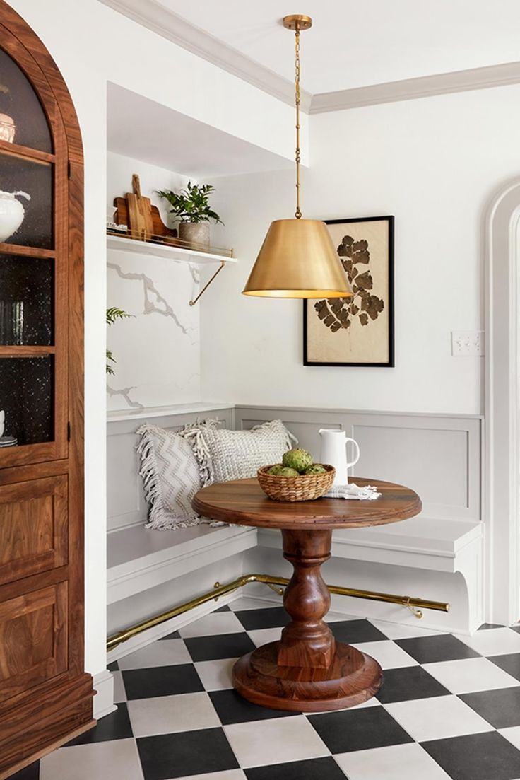 Breakfast Nook, love the brass foot rail, and how little space it occupies ! Definitely needs seat cushions for comfort.