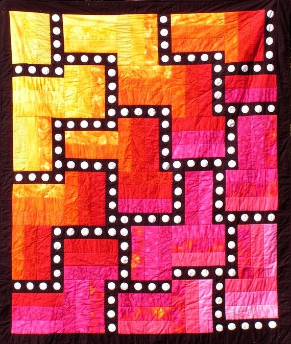 Hot Colors of Yellow, Orange, Red and Pink Form the Background for a Black Maze with White Appliqued Circles from the etsy shop of shquiltarts.