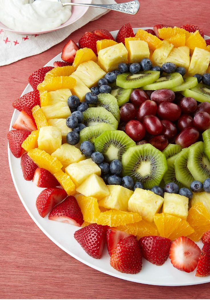 Sunburst Fruit Salad – Drizzled with a creamy honey-citrus sauce, our artfully arranged fruit salad almost looks too pretty to eat (Almost.)