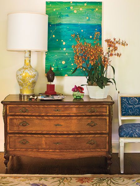 A Large Painted Canvas Gives This Formal Entryway A Splash