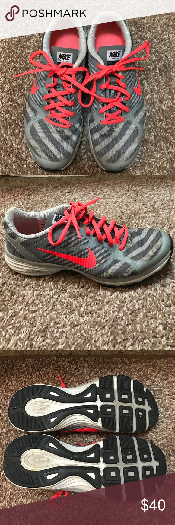 Nike dual fusion training shoes Light and dark grey stripes with neon orange accents. Size 7, only worn a few times, no rips or stains. Nike Shoes Athletic Shoes