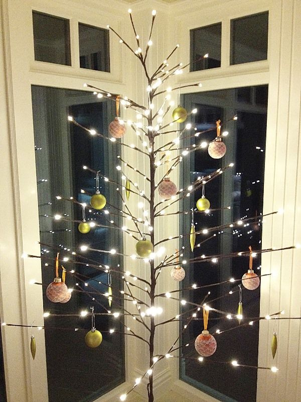 This minimalist design adds an entirely new dimension to the phrase 'alternative Christmas tree'
