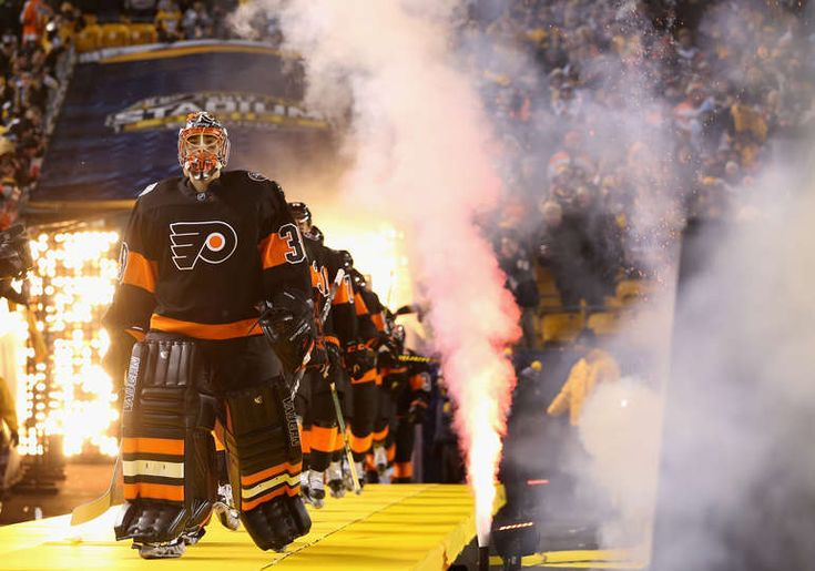 Penguins vs. Flyers - 02/25/2017 - Pittsburgh Penguins - Photos Goaltender Michal Neuvirth #30 of the Philadelphia Flyers walks out with his team