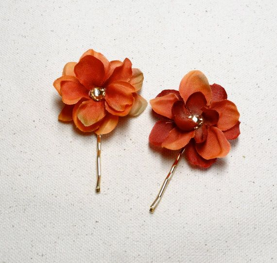 Two small flowers in burnt orange color, with gold-tone Swarovski crystal centers to sparkle and catch the light. Sold as a set of two. 1.5 diameter
