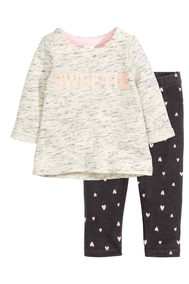Jersey set: Set with a top and trousers in cotton-blend jersey. Marled top with…