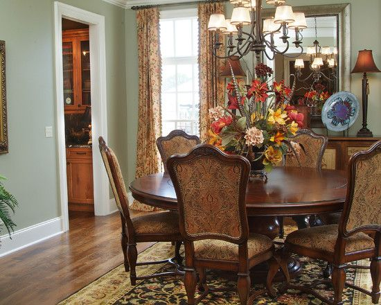 Decoration, Inspiring Round Wooden Dining Table And Classic French Chair On Persian Rug Below Black Wrought Iron Chandelier In Dining Room: Marvelous Cheap Flower Centerpiece Ideas as Decoration for Your Dining Table- Not a small dinning, but love the color & decor in this room!