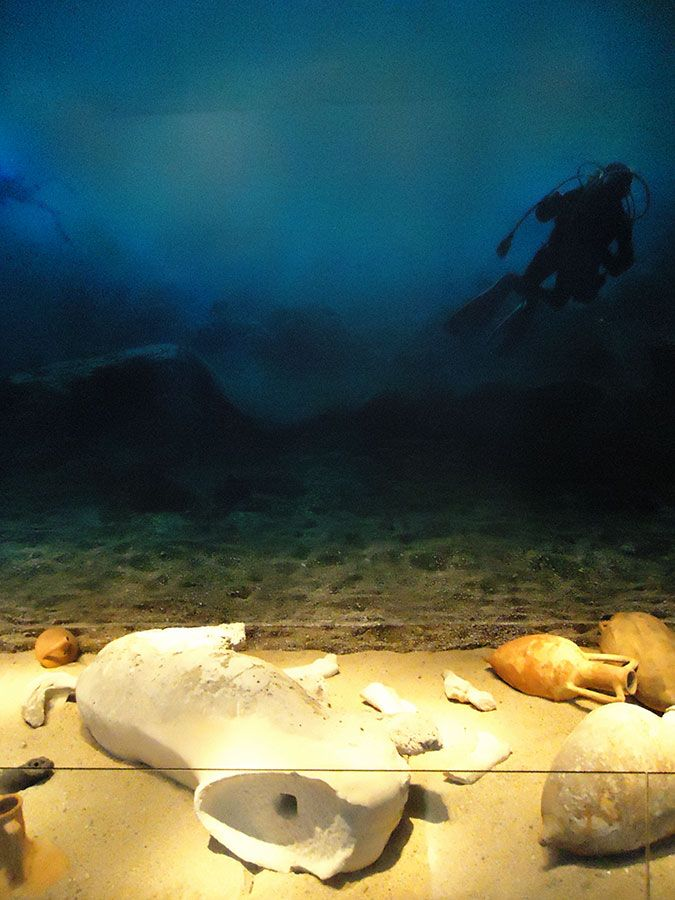 "The Antikythera Wreck is a shipwreck from  the 2nd quarter of the 1st century BC discovered by sponge divers on the Greek island of Antikythera in 1900. The display ""reconstructs"" how it was found. (National Archaeological Museum, Athens)"