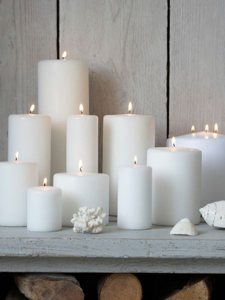 Stylish White Pillar Candles// i love using candles to compliment my themes