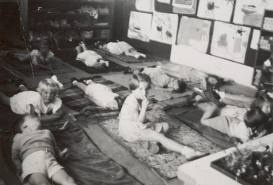 Nap-time at Kindergarten. I remember laying on my little mat....peeking around not wanting to close my eyes or rest. :)