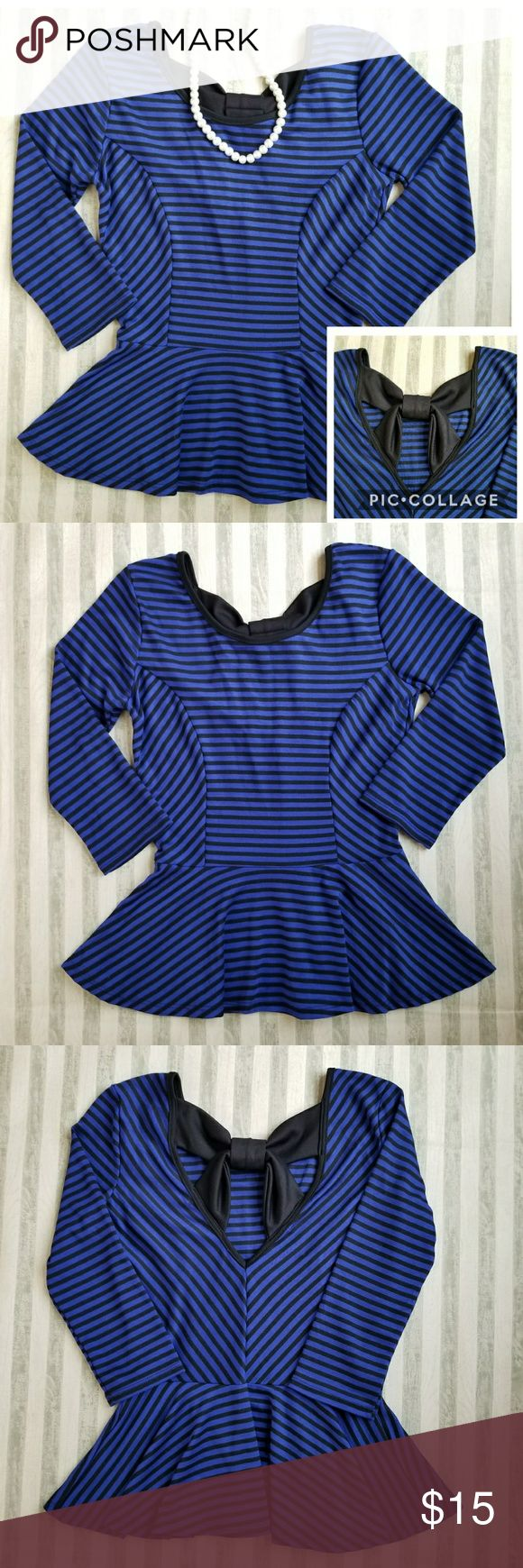 NWT Rue21 3/4 Sleeve Peplum Top Super cute Peplum top with bow detail at the back and can be worn dressy or casual. Has some stretch to it. In EXCELLENT Condition. NEW WITH TAG. Non-smoking home.  Feel free to ask.  Fabric: 87%polyester,  10% rayon and 3% spandex Rue21 Tops