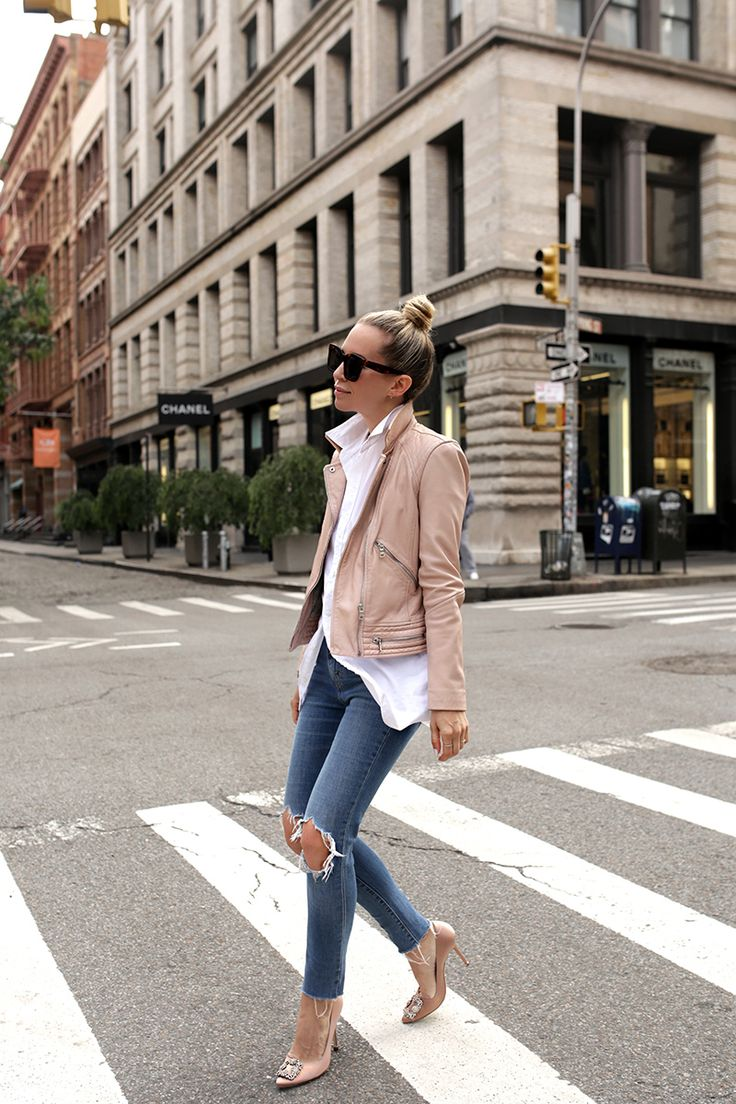 My go-to for stylish transitional weather minimal effort outfit is: blue jeans + a white button down and a luxe leather jacket!