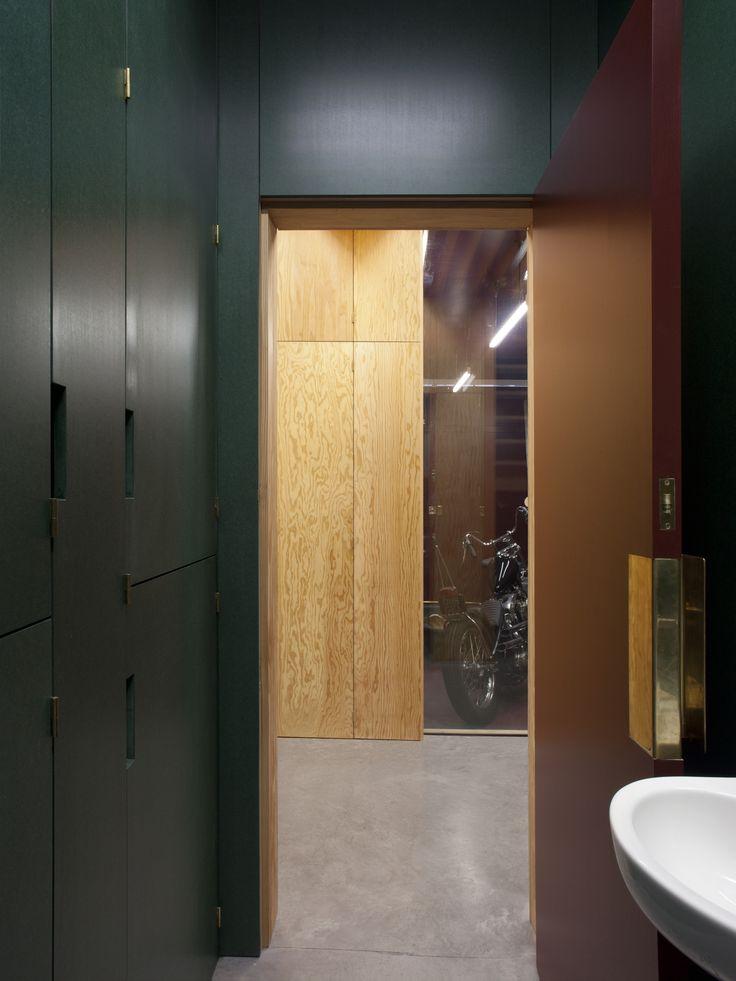 Frame House | Jonathan Tuckey Design, Holland Park, London, UK - Green Valchromat storage in the bathroom.