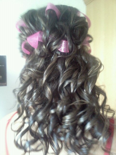 How I did Bethany's updo for Prom last year. All over curls/ half up do, with ribbon intertwined