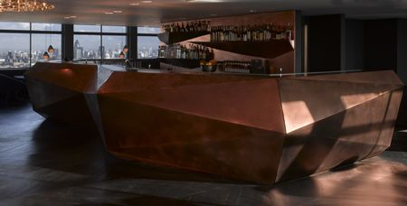Faceted copper back bar in Paramount by Tom Dixon.