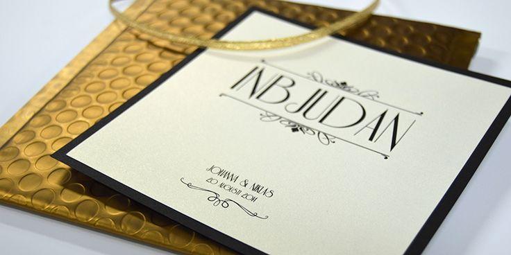 En enklare variant av inbjudningskortet Champagne guld, vi kallar den guld light. #artdeco