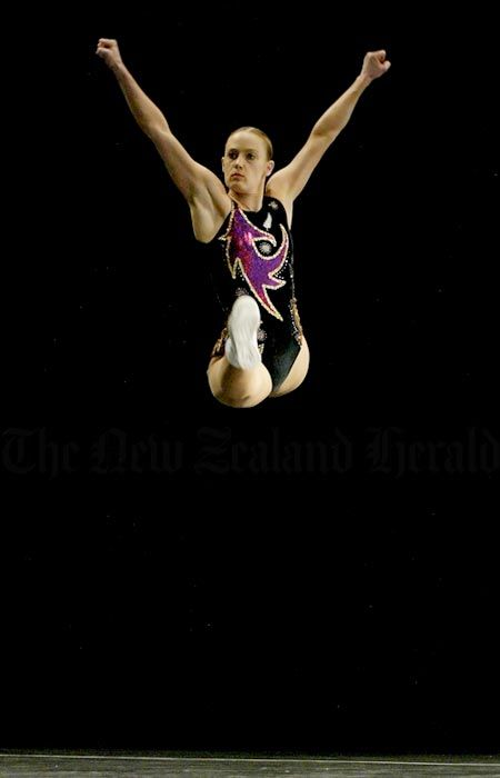Angela McMillan, the 2004 world aerobic gymnastics champion, takes to the air during the senior international individual championships in Auckland in 2005.