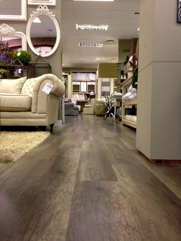 Laminate flooring installation at Biggie Best in the Waterstone Village mall by Cape Flooring.